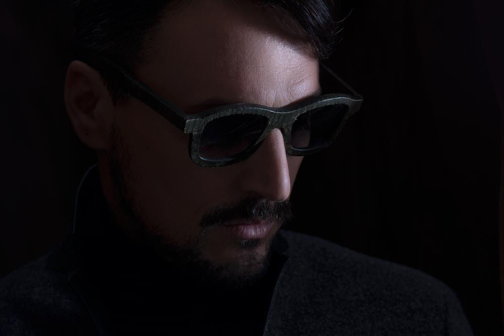 model wearing leather glasses lookbook shot